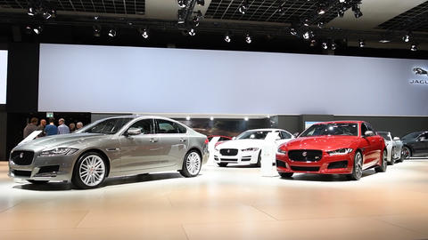 Jaguar motor show stand with the Jaguar XF and XE luxury saloon cars Live Action