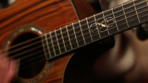 Man playing acoustic guitar close up Footage