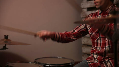 Expressive drummer playing drums with drum stick Footage
