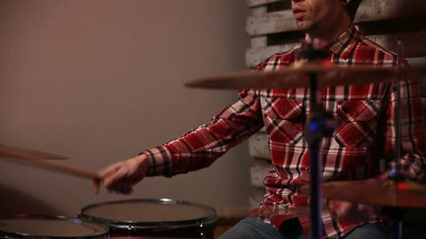 Attractive young man drummer playing on his kit Footage