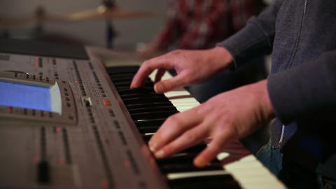 Young man playing electronic keyboard Footage