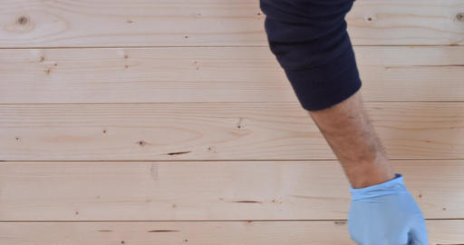 4K Time Lapse: Hand In Blue Gloves Painting Wooden Furniture Footage