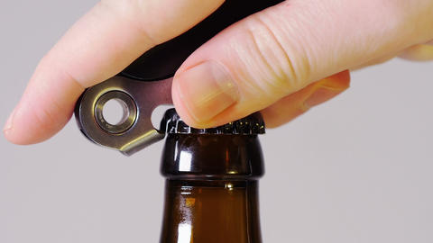 Brown beer bottle being opened Footage