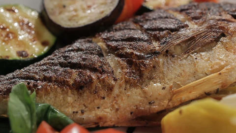 Grilled Fish Decorated with Vegetables on Dish Rounds Live Action