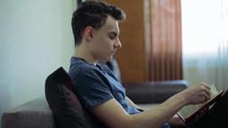 Teenager reading a novel Footage