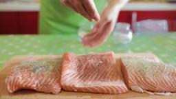 Seasoning salmon fillets Footage