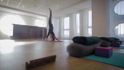 Yoga trainer executing a sequence Footage