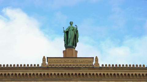 Historical statue atop district government of Upper Bavaria in Munich, Germany Footage
