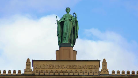 Lady Justice statue atop Upper Bavarian governmental building in Munich, Germany Footage