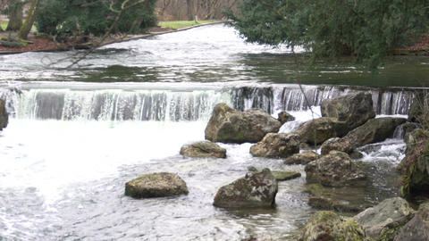 Relaxing waters of river waterfall, current splashing on stones, eternity, time Footage