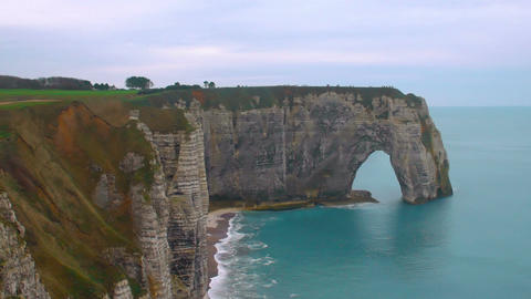 Natural stone arches, white chalk cliffs above English Channel, Etretat, France Footage