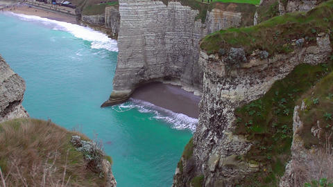 White chalk cliffs above English Channel, beautiful empty beach and azure water Footage