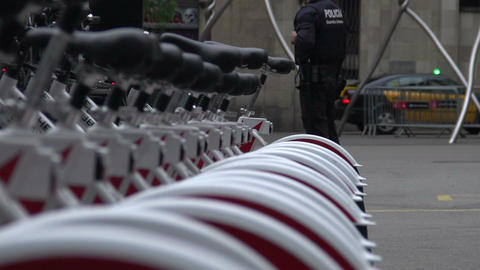 Policemen patrolling the city and providing security near bicycle parking Footage