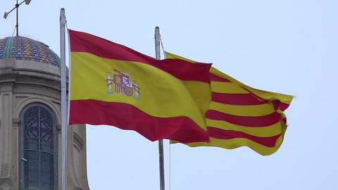 Beauty of two waving Spanish and Catalan flags, red, yellow colors, coat of arms Footage
