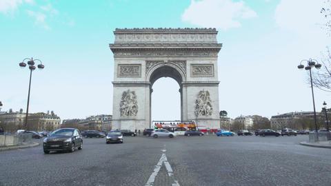 Double-decker bus passing Arc de Triomphe, tourists viewing places of interest Live Action