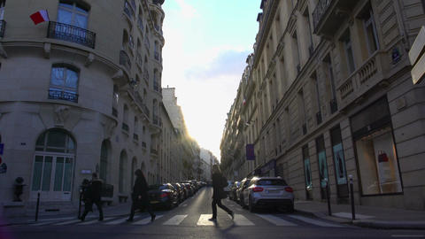 Pedestrians crossing street in European city, people walking home from work Footage