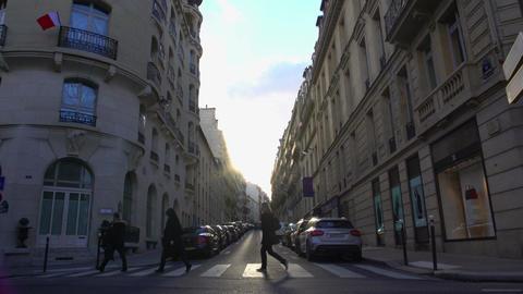 Pedestrians crossing street in European city, people walking home from work Footage
