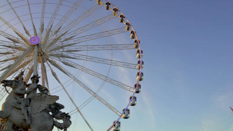 Mercury riding Pegasus marble statue and giant Ferris wheel in Tuileries Garden Footage