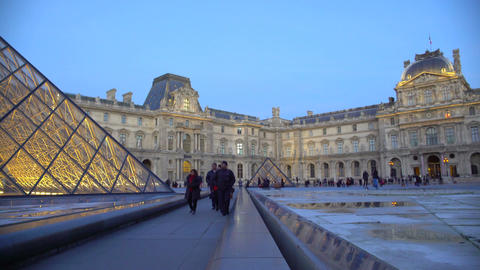 Fascinated people viewing majestic glass pyramids at famous Louvre Museum, Paris Footage