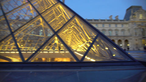 Crowds of travelers enjoying visit to Louvre Museum, viewing glass pyramids Footage
