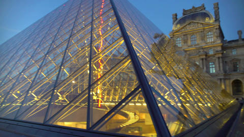 Pyramid at Louvre Museum in Paris, modern and classical architecture ensemble Footage