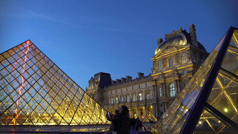 Louvre Museum visitors taking selfies near glass pyramids, amazing trip to Paris Footage