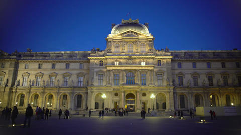 Crowds of tourists enjoying view of classical architecture of Louvre Palace Footage