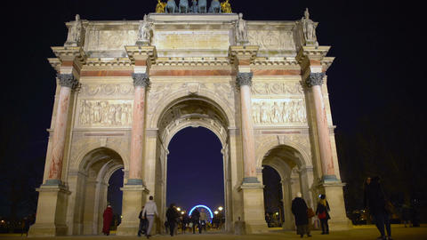 Tourists entering Tuileries Garden through triumphal arch in Place du Carrousel Footage