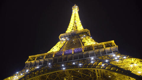Eiffel Tower construction starts shimmering with many lights in night Paris Footage