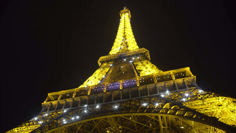Bright lights flashing on Eiffel Tower construction, romantic night in Paris Footage