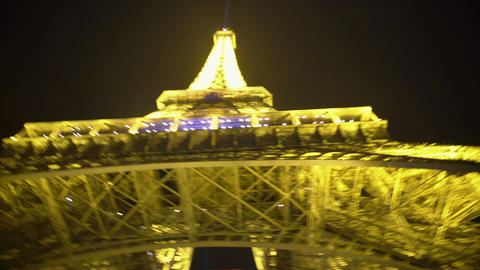 POV of person standing at Eiffel Tower bottom, viewing well-known sight in Paris Footage