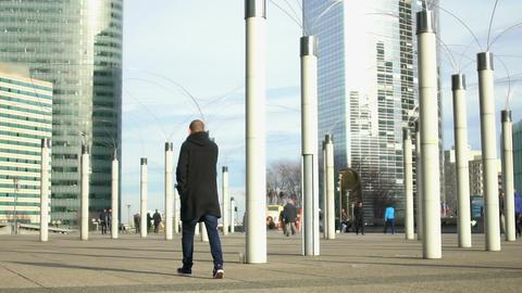Modern lampposts standing near skyscraper business center, creativity, art Footage