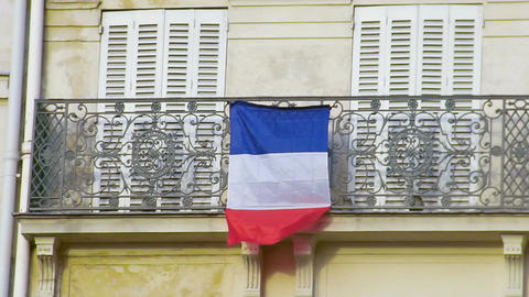French flag waving in wind on balcony, love for motherland, patriotic feelings Footage