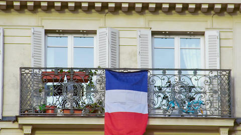Beautiful balcony with French flag, closeup. Patriotism, love for motherland Footage