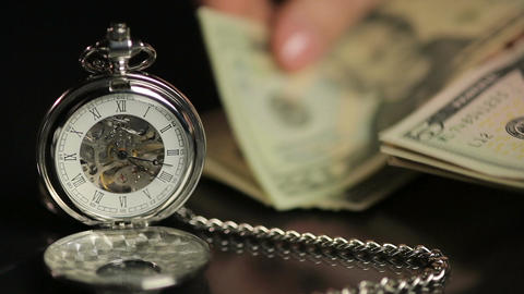 Hands counting US dollars near pocket watch, businessperson calculating profit Footage