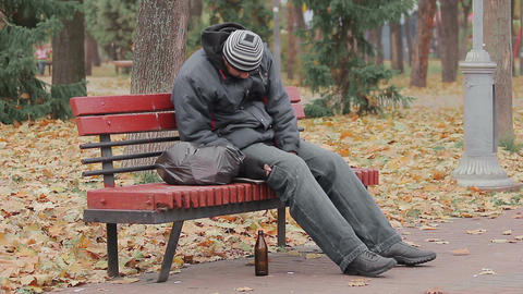 Disgusting drunk man sleeping and coughing on bench in city park, alcohol addict Footage