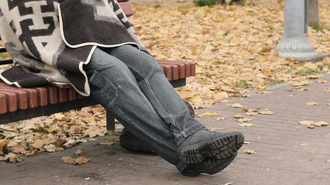 Pitiful jobless man sitting on bench in park, homelessness, social vulnerability Footage