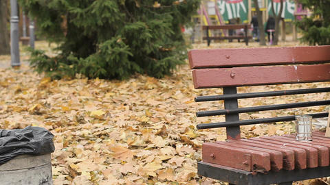 Old lonely poor person sitting on bench in park and asking for alms, poverty Footage