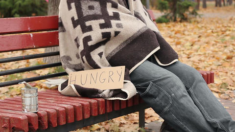 Hungry man wrapped in blanket begging, socially vulnerable homeless person Live Action