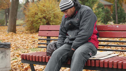 Manual worker sleeping drunk on bench, problems with health, unhealthy lifestyle Footage