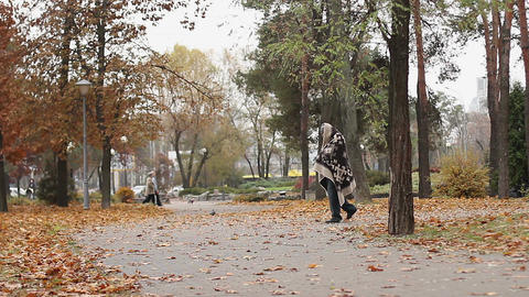 Tall man covered with blanket limping in park, mental disorder, homelessness Live Action