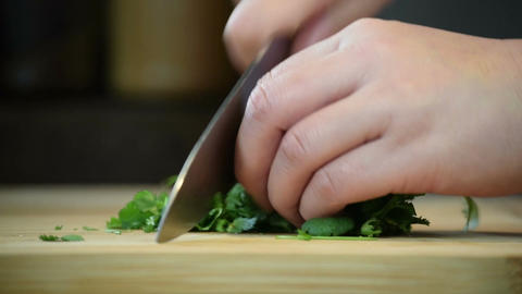 Chopping Small Bunch of Coriander For Garnishing Asian Dish Footage