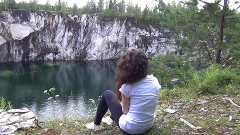 Woman Sitting on a Cliff Footage