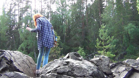 Redhead taking selfie using selfie stick Stock Video Footage