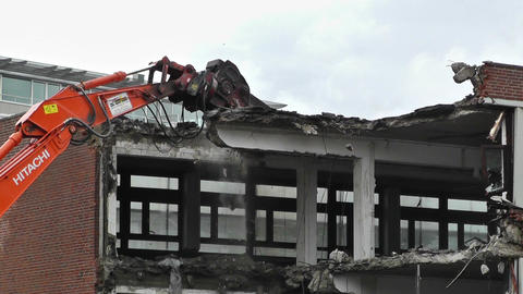 Machine Destroying Building 01 Stock Video Footage