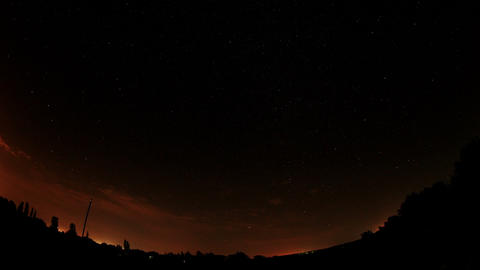 Time lapse of the night sky with clouds and stars passing... Stock Video Footage