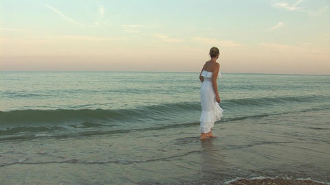 woman in waves c Stock Video Footage