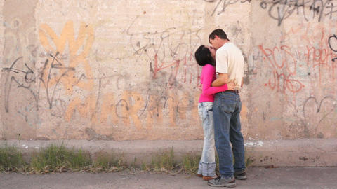 Lovers Meeting in an Alleyway and Kissing Stock Video Footage