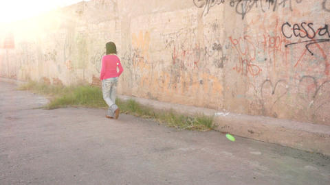 Woman Walking in Alley Into the Sun Stock Video Footage