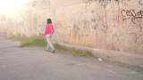 Woman Walking in Alley Into the Sun Footage